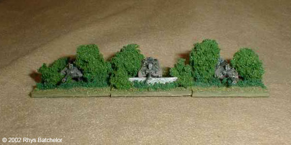 A well hidden Jagdpanzer Kannone company defends a tree line.